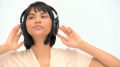 Cute asian woman listening to music Stock Footage