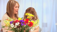 Cute little girl making a bunch of flowers Stock Footage