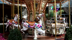 Merry Go Round kid's amusement park ride - stock footage