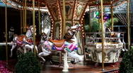 Merry Go Round kid's amusement park ride Stock Footage