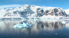 track through antarctic landscape with iceberg - stock footage