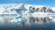 Stock Video Footage of track through antarctic landscape with iceberg