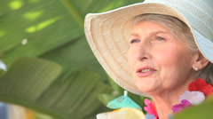 Mature woman with an hat holding a cocktail Stock Footage