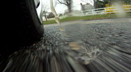 Car's tire hits a big puddle of rain (2) Stock Footage
