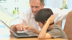 A grandfather giving some explanations to his grandson Stock Footage