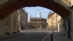 The Sheldonian Theatre through the 'Bridge of sighs' in Oxford, UK Stock Footage