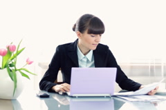 Overworked businesswoman sitting by the desk in the office - stock footage