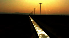 Long Irrigation Canal in Afternoon Sun Stock Footage
