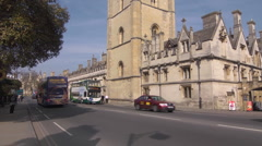 Oxford High Street with buses and traffic Stock Footage