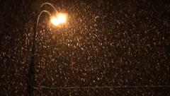 Snowstorm on illuminating lamp lights Stock Footage