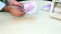 Hands Holding Stack Of 500 Euro Banknotes Stock Footage