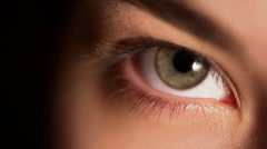 HD: extreme close-up of a green eye of a girl Stock Footage