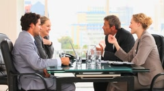 Four business people talking - stock footage