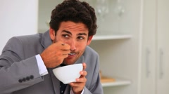 Businessman eating his breakfast quickly Stock Footage