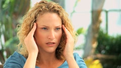 Curly haired woman having an headache Stock Footage