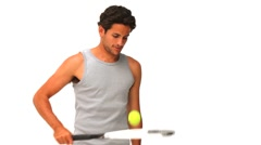 Dark-haired man with a racket and tennis ball - stock footage