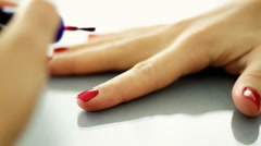 Woman painting her fingernails with red nail polish  Stock Footage