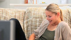 Cute woman laughing - stock footage