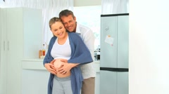 Lovely future parents in the kitchen Stock Footage