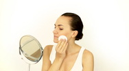 Stock Video Footage of Young attractive woman cleaning her face with cotton pad