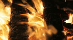 Two logs burning Stock Footage