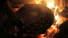 Cooking potato on fire in big pot with alcohol Stock Footage