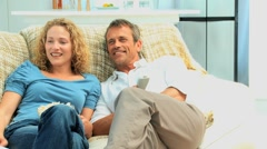 Cute couple watching the tv Stock Footage