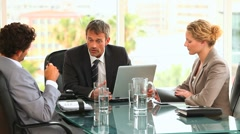 Three business people during a meeting - stock footage