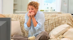 Stressed woman watching a match - stock footage