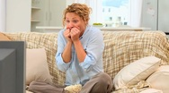 Stressed woman watching a match Stock Footage