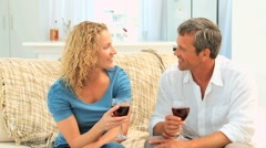 Couple savouring a red wine Stock Footage