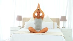 Woman doing yoga Stock Footage