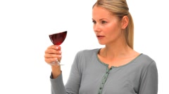 Casual blonde woman enjoying a glass of red wine Stock Footage