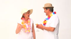 Mature couple with cocktails in vacacion Stock Footage