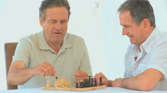 Retired friends playing chess Stock Footage