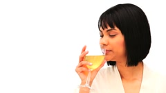 Attractive asian enjoying a glass of white wine Stock Footage