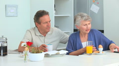 Retired couple taking a phone call Stock Footage