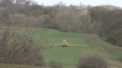 Crop sprayer towed by tractor. Stock Footage