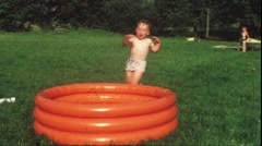 Children splashing in garden pool (vintage 8 mm amateur film) Stock Footage