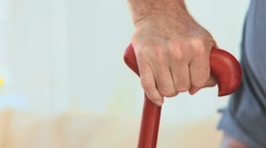 A man holding a walking stick Stock Footage