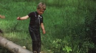 Stock Video Footage of Children making fitness exercises (vintage 8 mm amateur film)