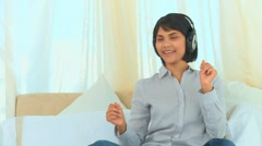 Casual chinese lady listening to music Stock Footage
