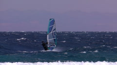 Windsurfing fall with the waves Stock Footage