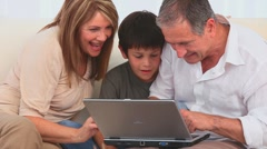 Family using a laptop to play a game Stock Footage