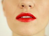 Woman applying red lipstick, close up Stock Footage