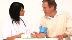 Asian nurse checking the blood pressure Stock Footage