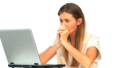 Sad woman looking at her laptop Stock Footage