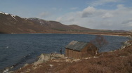 Small lodge at Loch Muick (6) zoom out Stock Footage