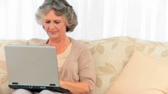 Stock Video Footage of Radiant retired woman looking at her laptop