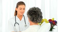 Nurse talking with her patient Stock Footage